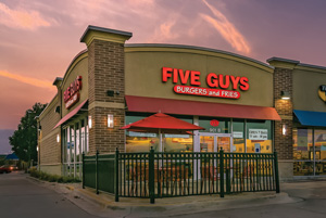 FIVE GUYS at dusk